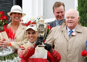 Jockey Joel Rosario with the 2013 Kentucky Derby trophy at Churchill Downs.