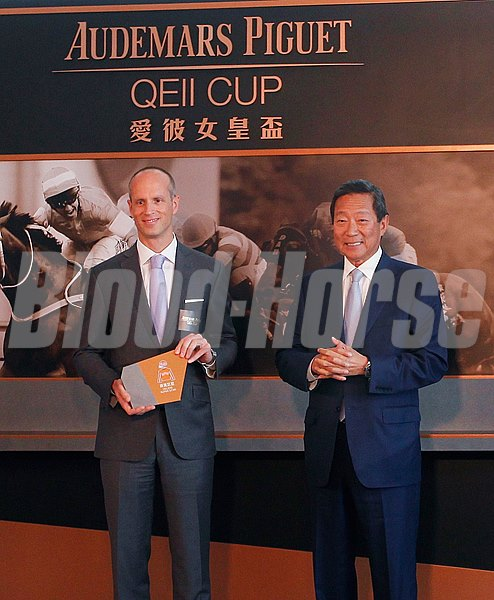 Dr. Simon S O Ip (right), Chairman of The Hong Kong Jockey Club and Mr. David von Gunten, CEO, Greater China of Audemars Piguet officiate at the barrier draw of Audemars Piguet QEII Cup.