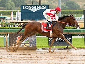 Songbird splashes through the slop well enough to take the grade I Santa Anita Oaks easily