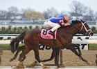 Outwork winning the Wood Memorial Stakes (gr. I)