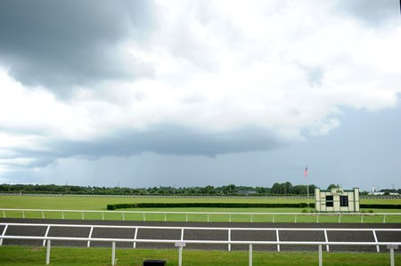 In this file shot, a storm arrives at the OBS Sales in Ocala, Fla., in June 2014.