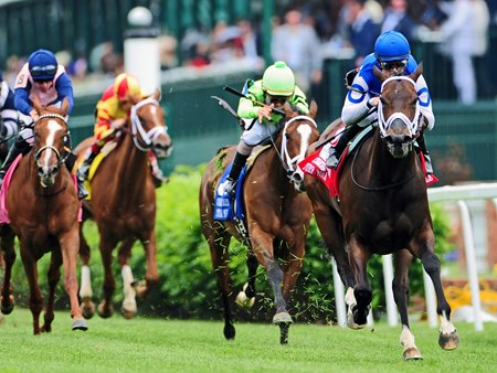 Tepin (right), with Julien Leparoux up, wins the Churchill Distaff Turf Mile (gr. IIT).