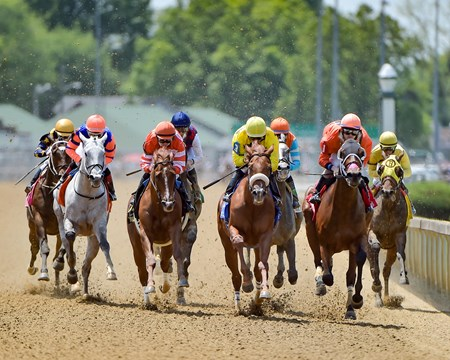The field in the Eight Belles (gr. II) rally down the backstretch at Churchill Downs.