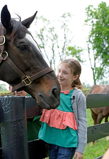 Tiana Holloway with her parents Lizzie and David visit Zenyatta as part of Make a Wish, on April 29, 2016.