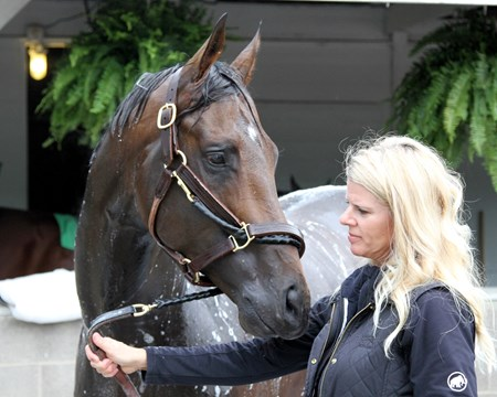 Exaggerator with assistant trainer Julie Clark at Churchill Downs on May 4, 2016.