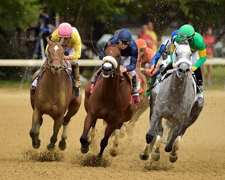Taris (center, blue cap) turns for the finish line the The Humana Distaff (gr. I) with Lavien Prat aboard.