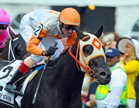 Ben's Cat, Trevor McCarthy up, wins the Jim McKay Turf Sprint at Pimlico for the 5th time.
