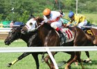 Linda's Luck (inside) and Bucket Beat hit wire together in May 29 Green Carpet Stakes