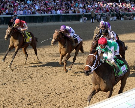 Cathryn Sophia (#12) with Javier Castellano win the 142nd Running of the Kentucky Oaks at Churchill Downs on May 6, 2016.