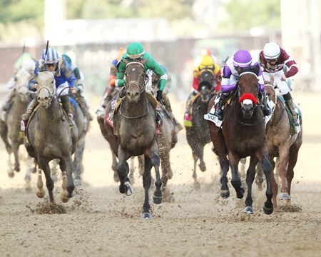 Exaggerator, center, running in the Kentucky Derby