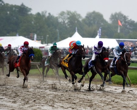 Nyquist leads into the first turn of the Preakness Stakes.