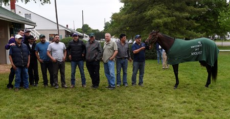2016 Kentucky Derby winner Nyquist poses with Team O'Neil members the day after the Derby in the barn area of Churchill Downs May 8, 2016 in Louisville, KY