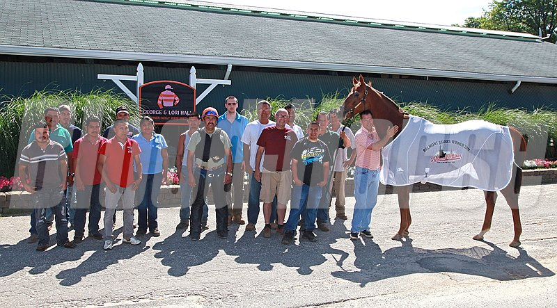 The Kelly Breen Stable poses outside their Monmouth Park Barn with Classic Winner Ruler On Ice, who was recently retired and will be heading to the Kentucky Farm of owners George and Lori Hall this week.  Ruler On Ice, a Six Year-Old son of Roman Ruler, won the 2011 Belmont Stakes with earnings of $1,709,566.00 during his racing career.