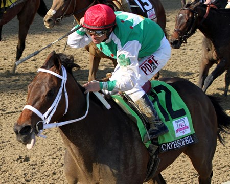 Javier Castellano celebrates after winning the 142nd Running of the Kentucky Oaks at Churchill Downs on May 6, 2016 aboard Cathryn Sophia.