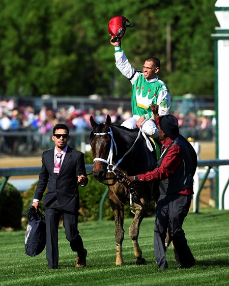 Jockey Javier Castellano raises his helmut in victory after riding Cathryn Sophia to the victory May 6, 2016 in the 142nd running of the Kentucky Oaks at Churchill Downs in Louisville, K.Y.