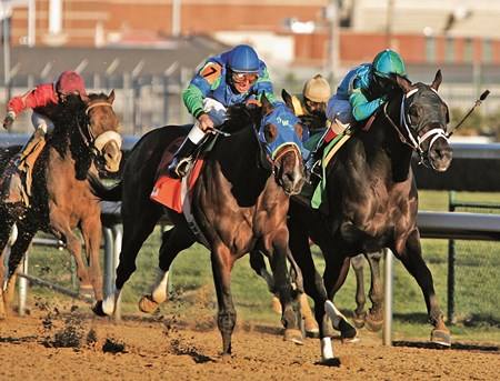 Magna Graduate, right, under jockey John Velazquez, held on for a narrow victory in the 131st running of the Clark Handicap at Churchill Downs in Louisville, Ky., Friday, Nov. 25, 2005.