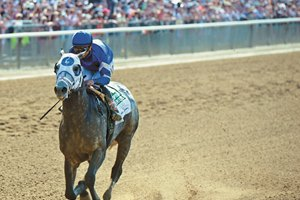 Frosted, Joel Rosario up, wins the Met Mile (gr. I) at Belmont.