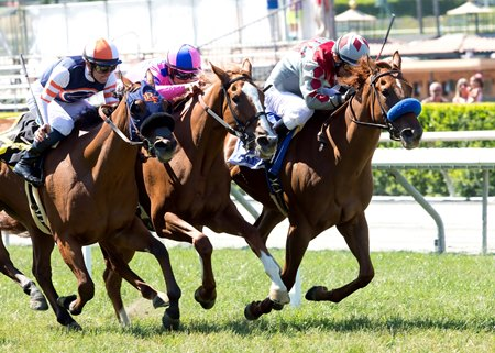 Be Mine (outside) and Stays In Vegas (inside) battle to the wire with eventual winner Cheekaboo (middle) in the Honeymoon Stakes June 19