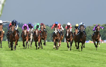 Even Song (left, dark blue silks) wins the 2016 Ribblesdale Stakes at Royal Ascot on June 16, 2016.