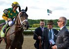 Cot Campbell leads Palace Malice into the winner's circle after the 2013 Belmont Stakes