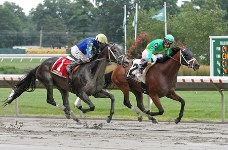 Genre, #2 with Paco Lopez riding, won the $100,000 Grade III Molly Pitcher at Monmouth Park on Sunday July 31, 2016 with Eskenformoney, ridden by Joe Bravo in a close second place.