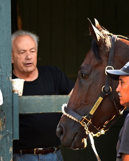 Trainer Jerry Hollendorfer watches his charge undefeated champion filly Songbird after she returns from exercise Friday morning at the Saratoga Race Course Friday July 23 2016 in Saratoga Springs, N.Y.