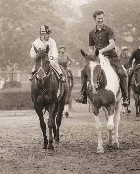 Seattle Slew with Jean Cruguet up (L) with trainer Billy Turner, Jr. on pony Steamboat (R). Seattle Slew and his team look confident as they head through the fog on the way to drill (June 2, 1977) for the $150,000 added Belmont Stakes (June 11, 1977)