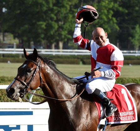 Jockey Mike Smith is exultant as he sits atop the undefeated Songbird after winning the 100th running of The Coaching Club American Oaks Sunday July 24 2016.