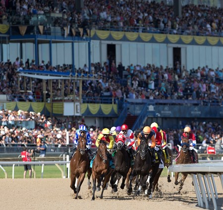 Sir Dudley Digges enters the first turn, middle red and white silks, of the Queen's Plate.