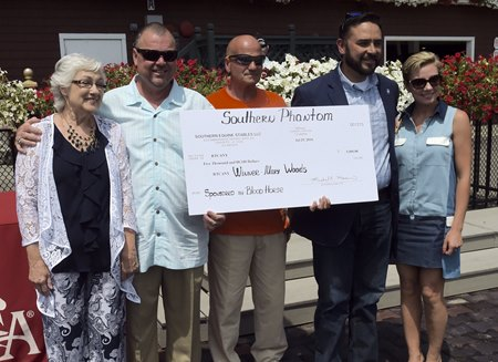 On hand July 30 for the check presentation were (left to right) Mary Beth Woods; Eric Guillot; Nick Cara and Humberto Chavez of the RTCA; and Anna Guillot.
