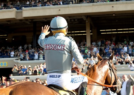 California Chrome and jockey Victor Espinoza, return victorious to the winner's circle after victory in the San Diego Handicap Saturday, July 23, 2016.