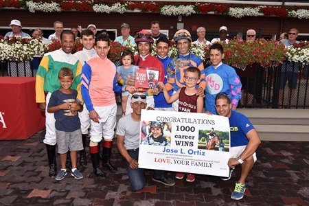 Jose Ortiz celebrating his 1000th win