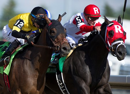 Sir Dudley Digges (Red white silks R) wins the Queen's Plate Stakes at Woodbine Racetrack in Toronto Ont. July 3, 2016