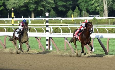 Songbird with jockey Mike Smith outruns Carina Mia with jockey Julien Leparoux to win the 100th running of The Coaching Club American Oaks Sunday July 24 2016