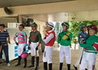 Jockeys in the Ellis Park paddock waiting for a thunderstorm to pass July 29