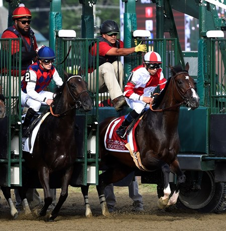 Songbird with jockey Mike Smith breaks from the gate next to Carina Mia with jockey Julien Leparoux in the 100th running of The Coaching Club American Oaks