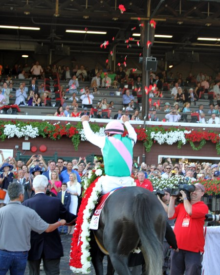 Mike Smith and Arrogate enter the winners' circle after setting a track record in the 147th Running of the Travers Stakes at Saratoga on August 27, 2016.