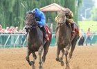 Innovative Idea (left) gets the victory in the Groupie Doll
