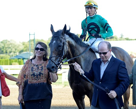 Owners Gerald and Susan Kreesa lead in King Kreesa with Jose Ortiz on Aug. 26, 2016, in Saratoga Springs, N.Y.