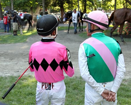 Jockeys Mike Smith and Rafael Bejarano talk while Arrogate (#1) and American Freedom (#2) walk in the paddock prior to finishing first and second in the 147th Running of the Travers (GI) at Saratoga on August 27, 2016.