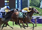 Cavorting, winning the Personal Ensign Stakes, her second grade I win for the year
