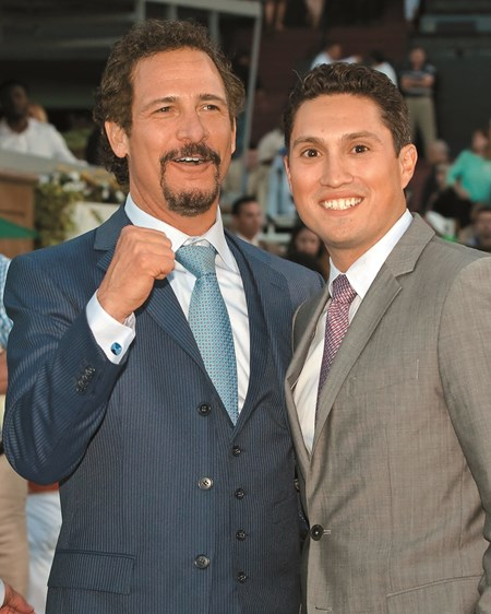 Co-owners Jim Rome, left, and Alex Solis II celebrate after Shared Belief and jockey Mike Smith made easy work of the $1,000,000 Grade I Santa Anita Handicap Saturday, March 7, 2015 Santa Anita in Arcadia, CA.