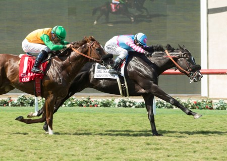 Midnight Storm and jockey Rafael Bejarano, right, overpower Om (Gary Stevens), left, to win the Grade II, $200,000 Del Mar Mile, Sunday, Aug. 21, 2016 at Del Mar Thoroughbred Club, Del Mar CA.