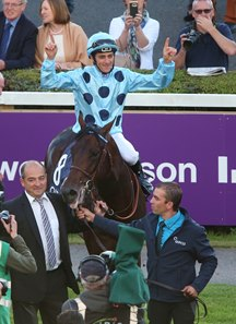 Christophe Soumillon celebrates after winning the Irish Champion Stakes aboard Almanzor