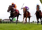 Harbour Law (left, orange silks) gets up late to take the St. Leger.