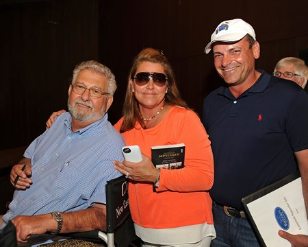 Buyer J. J. Crupi, left, with Samantha and Chris Baccari.