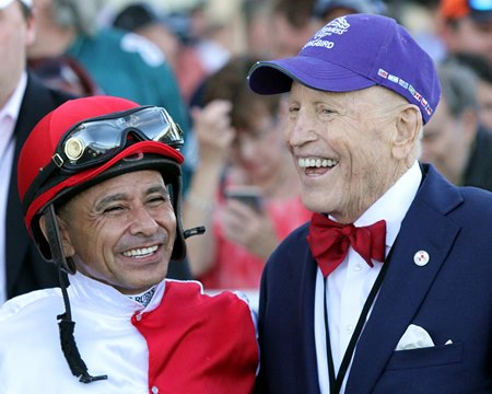 Owner Rick Porter with jockey Mike Smith after Songbird won the Cotillion