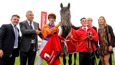 Harbour Law and George Baker (orange) win the 2016 Ladbrokes St Leger