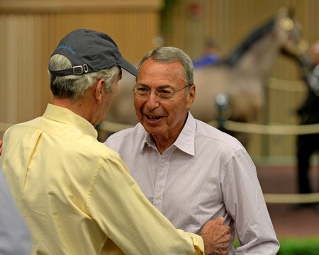 Brereton Jones (back to camera) congratulates buyer William Mack. Hip 207 colt by TApit from Believe You Can from Brereton C. Jones/Airdrie brings $900,000 Yearlings at Keeneland on Sept. 13, 2016, in Lexington, Ky.