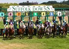 Horses break from the gate at Suffolk Downs